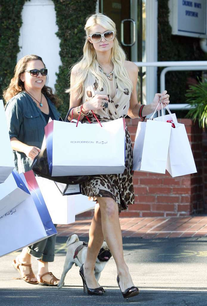 #5617439 It took four extra pairs of hands to assist Paris Hilton as she carries the numerous bags of purchases after loading up on fall fashions at Fred Segal in Beverly Hills, Ca on August 23, 2010. Paris even brought along her furry little BFF, pooch Mugsy, to aid her in this afternoon's shopping extravaganza!   Fame Pictures, Inc - Santa Monica, CA, USA - +1 (310) 395-0500